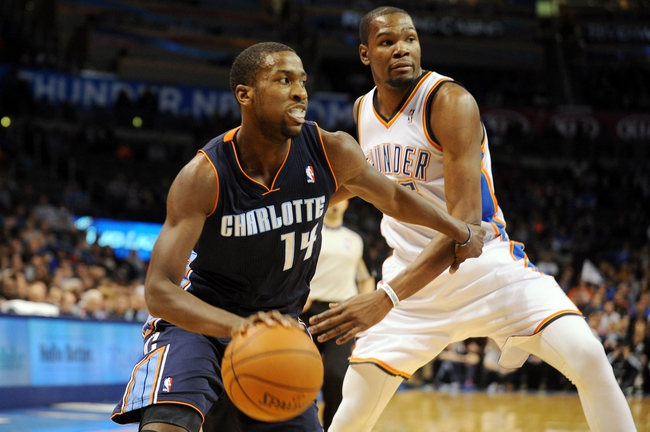 Mar 2, 2014; Oklahoma City, OK, USA; Charlotte Bobcats small forward Michael Kidd-Gilchrist (14) handles the ball against Oklahoma City Thunder small forward Kevin Durant (35) during the first quarter at Chesapeake Energy Arena. Mandatory Credit: Mark D. Smith-USA TODAY Sports
