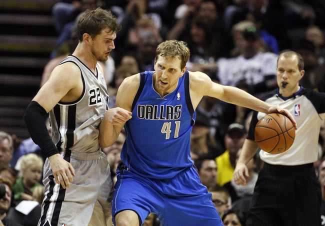 Mar 2, 2014; San Antonio, TX, USA; Dallas Mavericks forward Dirk Nowitzki (41) is defended by San Antonio Spurs forward Tiago Splitter (22) during the first half at AT&T Center. Mandatory Credit: Soobum Im-USA TODAY Sports