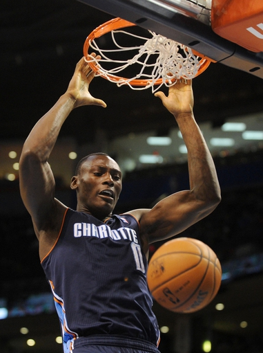 Mar 2, 2014; Oklahoma City, OK, USA; Charlotte Bobcats center Bismack Biyombo (0) dunks the ball against the Oklahoma City Thunder during the second quarter at Chesapeake Energy Arena. Mandatory Credit: Mark D. Smith-USA TODAY Sports