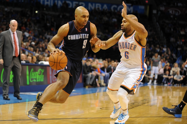 Mar 2, 2014; Oklahoma City, OK, USA; Charlotte Bobcats shooting guard Gerald Henderson (9) handles the ball against Oklahoma City Thunder point guard Derek Fisher (6) during the second quarter at Chesapeake Energy Arena. Mandatory Credit: Mark D. Smith-USA TODAY Sports