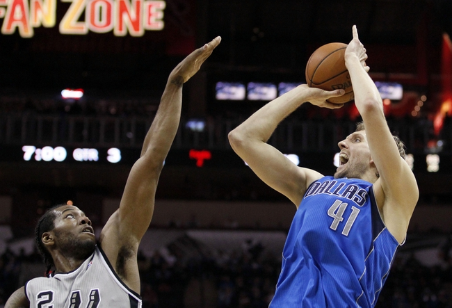 Mar 2, 2014; San Antonio, TX, USA; Dallas Mavericks forward Dirk Nowitzki (41) takes a shot over San Antonio Spurs forward Kawhi Leonard (2) during the second half at AT&T Center. Mandatory Credit: Soobum Im-USA TODAY Sports