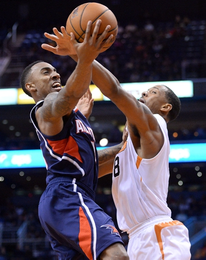 Mar 2, 2014; Phoenix, AZ, USA; Atlanta Hawks point guard Jeff Teague (0) goes up for a layup over Phoenix Suns power forward Channing Frye (8) during the first half at US Airways Center. Mandatory Credit: Joe Camporeale-USA TODAY Sports