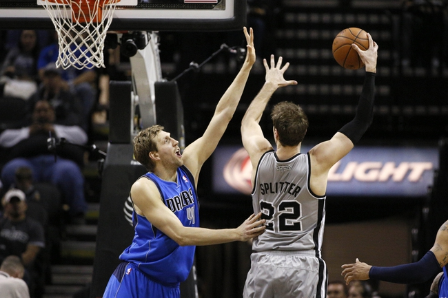 Mar 2, 2014; San Antonio, TX, USA; San Antonio Spurs forward Tiago Splitter (22) shoots as Dallas Mavericks forward Dirk Nowitzki (left) defends during the second half at AT&T Center. The Spurs won 112-106. Mandatory Credit: Soobum Im-USA TODAY Sports