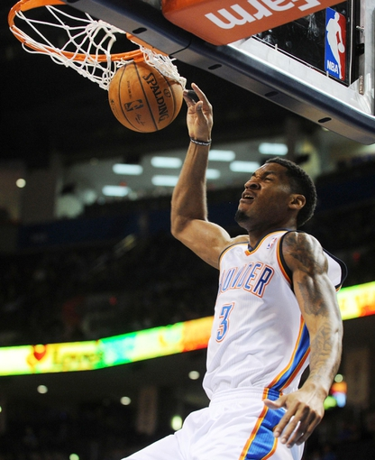 Mar 2, 2014; Oklahoma City, OK, USA; Oklahoma City Thunder small forward Perry Jones (3) dunks the ball against the Charlotte Bobcats during the third quarter at Chesapeake Energy Arena. Mandatory Credit: Mark D. Smith-USA TODAY Sports