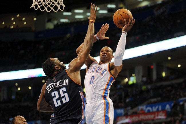 Mar 2, 2014; Oklahoma City, OK, USA; Oklahoma City Thunder point guard Russell Westbrook (0) attempts a shot against Charlotte Bobcats center Al Jefferson (25) during the fourth quarter at Chesapeake Energy Arena. Mandatory Credit: Mark D. Smith-USA TODAY Sports