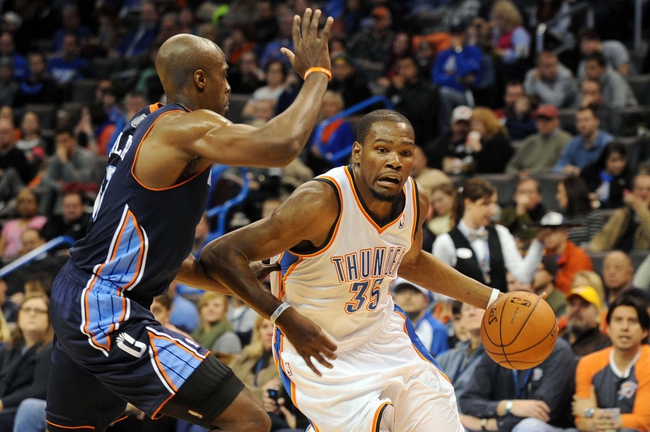 Mar 2, 2014; Oklahoma City, OK, USA; Oklahoma City Thunder small forward Kevin Durant (35) handles the ball against Charlotte Bobcats power forward Anthony Tolliver (43) during the fourth quarter at Chesapeake Energy Arena. Mandatory Credit: Mark D. Smith-USA TODAY Sports