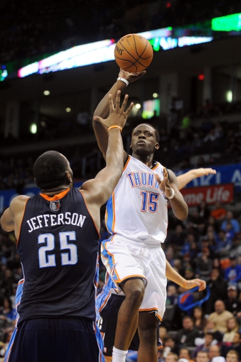 Mar 2, 2014; Oklahoma City, OK, USA; Oklahoma City Thunder point guard Reggie Jackson (15) attempts a shot against Charlotte Bobcats center Al Jefferson (25) during the third quarter at Chesapeake Energy Arena. Mandatory Credit: Mark D. Smith-USA TODAY Sports