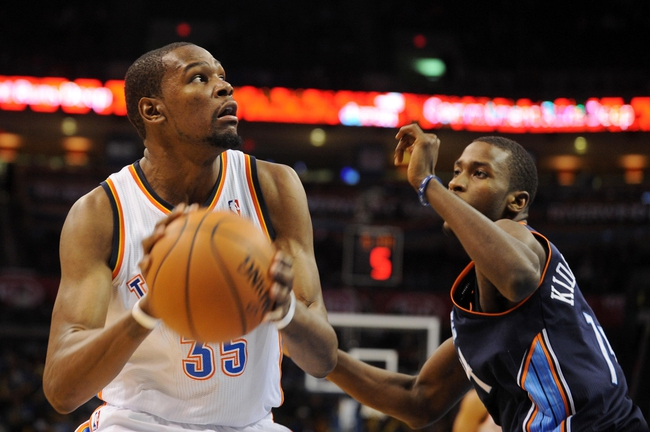 Mar 2, 2014; Oklahoma City, OK, USA; Oklahoma City Thunder small forward Kevin Durant (35) handles the ball against Charlotte Bobcats small forward Michael Kidd-Gilchrist (14) during the third quarter at Chesapeake Energy Arena. Mandatory Credit: Mark D. Smith-USA TODAY Sports