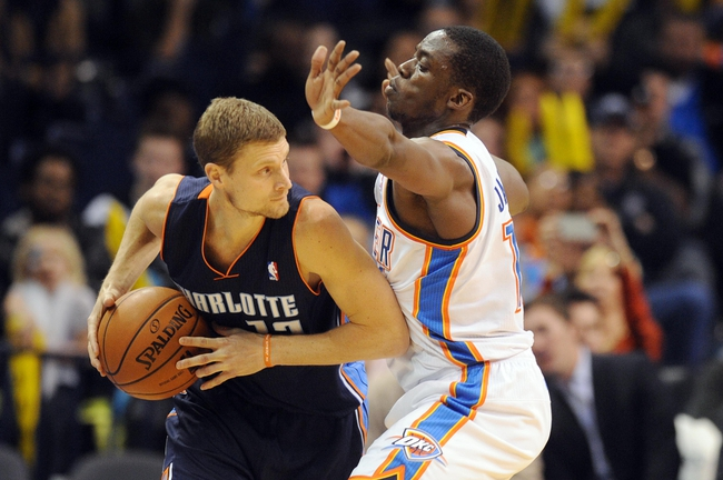 Mar 2, 2014; Oklahoma City, OK, USA; Charlotte Bobcats point guard Luke Ridnour (13) handles the ball against Oklahoma City Thunder point guard Reggie Jackson (15) during the third quarter at Chesapeake Energy Arena. Mandatory Credit: Mark D. Smith-USA TODAY Sports
