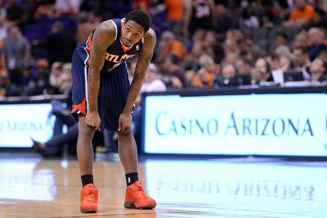 Mar 2, 2014; Phoenix, AZ, USA; Atlanta Hawks shooting guard Louis Williams (3) looks on in the final seconds of the second half  against the Phoenix Suns at US Airways Center. The Phoenix Suns won the game 129-120. Mandatory Credit: Joe Camporeale-USA TODAY Sports