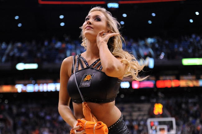 Mar 2, 2014; Phoenix, AZ, USA; A Phoenix Suns Dancer performs against the Atlanta Hawks during the second half at US Airways Center. The Phoenix Suns won the game 129-120. Mandatory Credit: Joe Camporeale-USA TODAY Sports