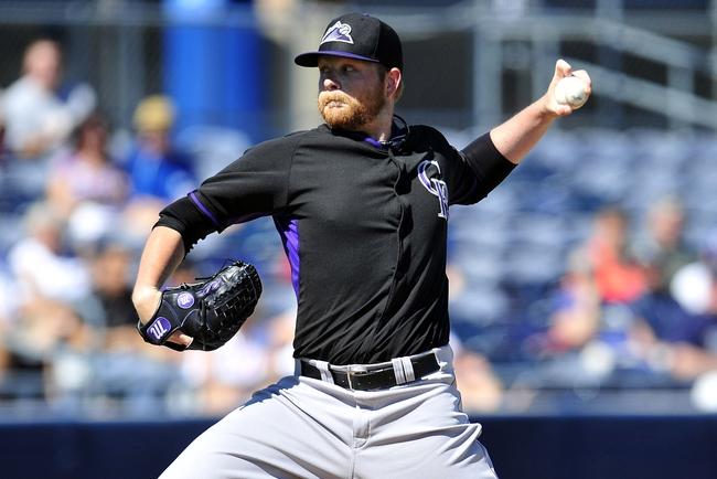 March 3, 2014; Peoria, AZ, USA; Colorado Rockies starting pitcher Brett Anderson (30) pitches against the Seattle Mariners at Peoria Sports Complex. Mandatory Credit: Gary A. Vasquez-USA TODAY Sports