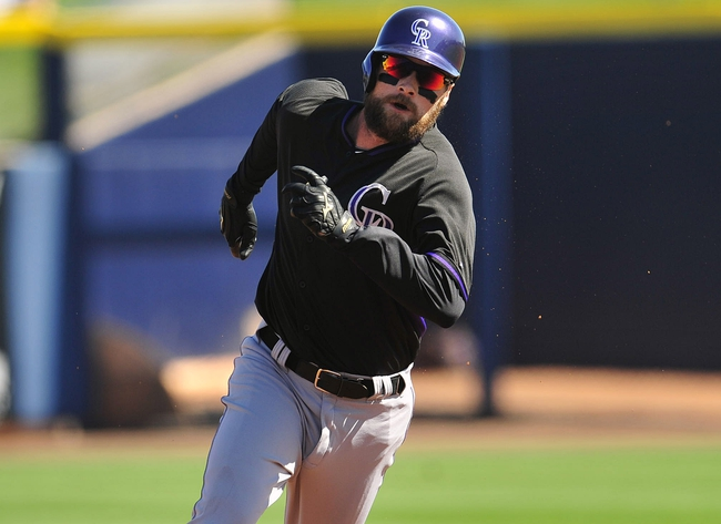 March 3, 2014; Peoria, AZ, USA; Colorado Rockies first baseman Ben Paulsen (36) runs to third after hitting a triple in the second inning against the Seattle Mariners at Peoria Sports Complex. Mandatory Credit: Gary A. Vasquez-USA TODAY Sports