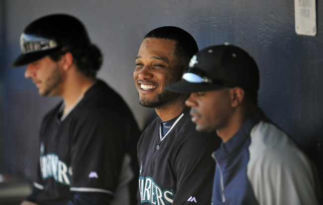 March 3, 2014; Peoria, AZ, USA; Seattle Mariners second baseman Robinson Cano (22) watches game action during the second inning against the Colorado Rockies at Peoria Sports Complex. Mandatory Credit: Gary A. Vasquez-USA TODAY Sports