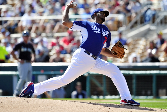 March 4, 2014; Phoenix, AZ, USA; Los Angeles Dodgers relief pitcher Kenley Jansen (74) pitches the second inning against the Seattle Mariners at Camelback Ranch. Mandatory Credit: Gary A. Vasquez-USA TODAY Sports