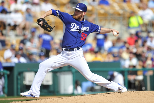 March 4, 2014; Phoenix, AZ, USA; Los Angeles Dodgers relief pitcher J.P. Howell (56) pitches the third inning against the Seattle Mariners at Camelback Ranch. Mandatory Credit: Gary A. Vasquez-USA TODAY Sports