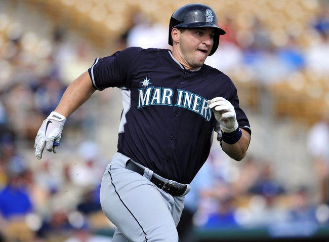 March 4, 2014; Phoenix, AZ, USA; Seattle Mariners catcher Mike Zunino (3) runs after hitting a double in the fourth inning against the Los Angeles Dodgers at Camelback Ranch. Mandatory Credit: Gary A. Vasquez-USA TODAY Sports