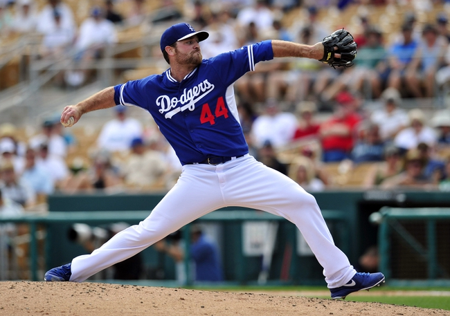 March 4, 2014; Phoenix, AZ, USA; Los Angeles Dodgers relief pitcher Chris Withrow (44) pitches in the fifth inning against the Seattle Mariners at Camelback Ranch. Mandatory Credit: Gary A. Vasquez-USA TODAY Sports