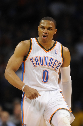 Mar 4, 2014; Oklahoma City, OK, USA; Oklahoma City Thunder point guard Russell Westbrook (0) reacts after a made 3 point shot against the Philadelphia 76ers during the second quarter at Chesapeake Energy Arena. Mandatory Credit: Mark D. Smith-USA TODAY Sports
