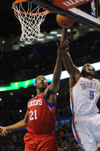 Mar 4, 2014; Oklahoma City, OK, USA; Oklahoma City Thunder power forward Serge Ibaka (9) blocks a shot attempt by Philadelphia 76ers power forward Thaddeus Young (21) during the second quarter at Chesapeake Energy Arena. Mandatory Credit: Mark D. Smith-USA TODAY Sports