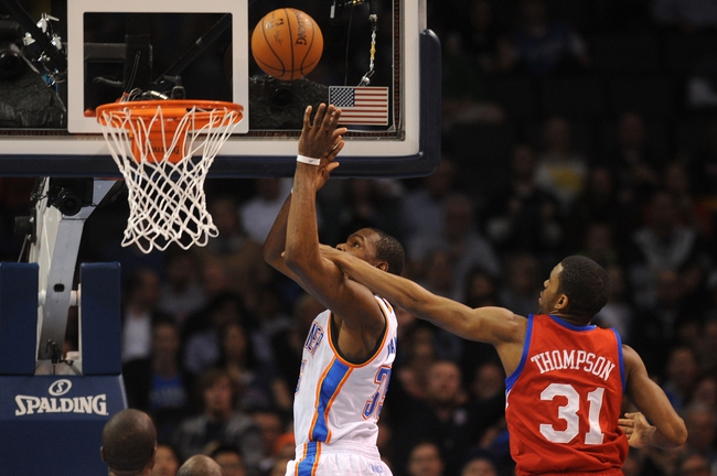 Mar 4, 2014; Oklahoma City, OK, USA; Oklahoma City Thunder small forward Kevin Durant (35) is fouled on a shot attempt by Philadelphia 76ers shooting guard Hollis Thompson (31) during the second quarter at Chesapeake Energy Arena. Mandatory Credit: Mark D. Smith-USA TODAY Sports