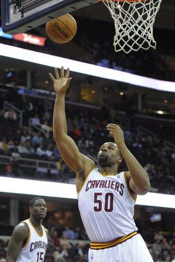 Mar 4, 2014; Cleveland, OH, USA; Cleveland Cavaliers power forward Arinze Onuaku (50) grabs a rebound in the fourth quarter against the San Antonio Spurs at Quicken Loans Arena. Mandatory Credit: David Richard-USA TODAY Sports