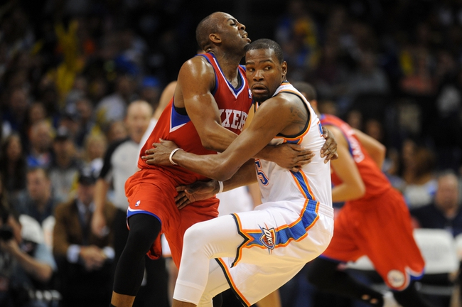 Mar 4, 2014; Oklahoma City, OK, USA; Oklahoma City Thunder small forward Kevin Durant (35) is fouled away from the ball by Philadelphia 76ers shooting guard James Anderson (9) during the third quarter at Chesapeake Energy Arena. Mandatory Credit: Mark D. Smith-USA TODAY Sports
