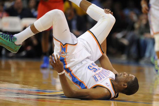 Mar 4, 2014; Oklahoma City, OK, USA; Oklahoma City Thunder small forward Kevin Durant (35) falls to the floor after being fouled on a 3 point attempt in action against Philadelphia 76ers during the third quarter at Chesapeake Energy Arena. Mandatory Credit: Mark D. Smith-USA TODAY Sports