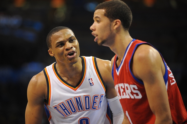 Mar 4, 2014; Oklahoma City, OK, USA; Oklahoma City Thunder point guard Russell Westbrook (0) talks to Philadelphia 76ers point guard Michael Carter-Williams (1) during the third quarter at Chesapeake Energy Arena. Mandatory Credit: Mark D. Smith-USA TODAY Sports