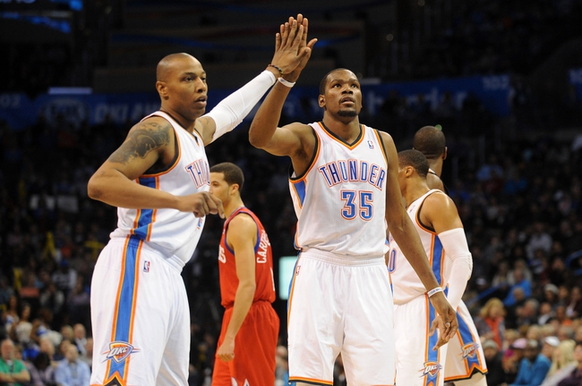 Mar 4, 2014; Oklahoma City, OK, USA; Oklahoma City Thunder small forward Caron Butler (2) congratulates Oklahoma City Thunder small forward Kevin Durant (35) after a made shot against the Philadelphia 76ers at Chesapeake Energy Arena. Mandatory Credit: Mark D. Smith-USA TODAY Sports