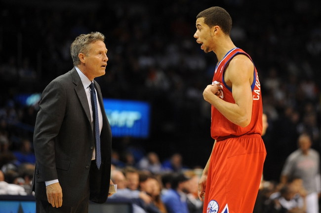 Mar 4, 2014; Oklahoma City, OK, USA; Philadelphia 76ers head coach Brett Brown speaks to Philadelphia 76ers point guard Michael Carter-Williams (1) during a break in action against the OKlahoma City Thunder at Chesapeake Energy Arena. Mandatory Credit: Mark D. Smith-USA TODAY Sports