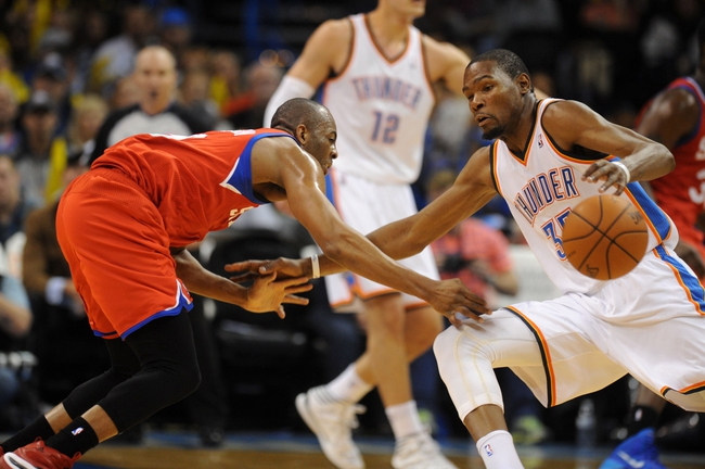 Mar 4, 2014; Oklahoma City, OK, USA; Oklahoma City Thunder small forward Kevin Durant (35) handles the ball against Philadelphia 76ers shooting guard James Anderson (9) during the third quarter at Chesapeake Energy Arena. Mandatory Credit: Mark D. Smith-USA TODAY Sports