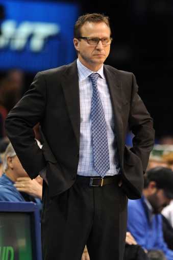 Mar 4, 2014; Oklahoma City, OK, USA; Oklahoma City Thunder head coach Scott Brooks watches his team in action against the Philadelphia 76ers during the third quarter at Chesapeake Energy Arena. Mandatory Credit: Mark D. Smith-USA TODAY Sports