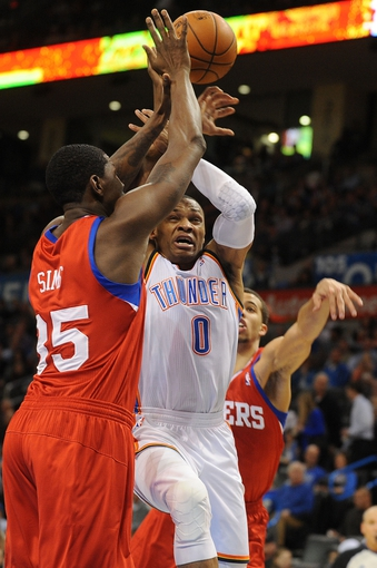 Mar 4, 2014; Oklahoma City, OK, USA; Oklahoma City Thunder point guard Russell Westbrook (0) drives to the basket against Philadelphia 76ers center Henry Sims (35) during the third quarter at Chesapeake Energy Arena. Mandatory Credit: Mark D. Smith-USA TODAY Sports
