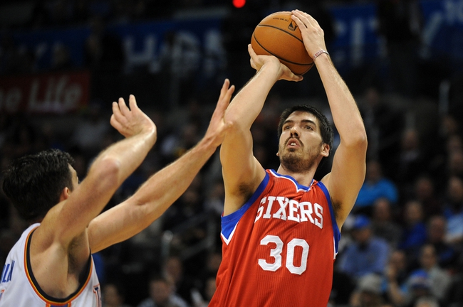 Mar 4, 2014; Oklahoma City, OK, USA; Philadelphia 76ers center Byron Mullens (30) attempts a shot against Oklahoma City Thunder power forward Nick Collison (4) during the second quarter at Chesapeake Energy Arena. Mandatory Credit: Mark D. Smith-USA TODAY Sports