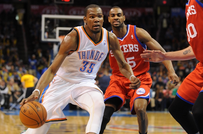 Mar 4, 2014; Oklahoma City, OK, USA; Oklahoma City Thunder small forward Kevin Durant (35) handles the ball against Philadelphia 76ers shooting guard Elliot Williams (25) during the third quarter at Chesapeake Energy Arena. Mandatory Credit: Mark D. Smith-USA TODAY Sports