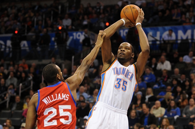 Mar 4, 2014; Oklahoma City, OK, USA; Oklahoma City Thunder small forward Kevin Durant (35) attempts a shot against Philadelphia 76ers shooting guard Elliot Williams (25) during the third quarter at Chesapeake Energy Arena. Mandatory Credit: Mark D. Smith-USA TODAY Sports