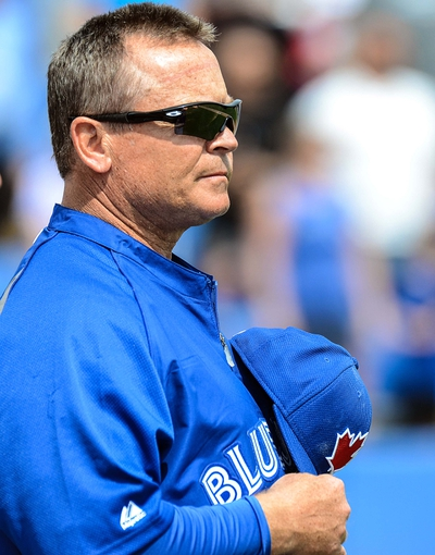 Mar 5, 2014; Dunedin, FL, USA; Toronto Blue Jays manager John Gibbons (5) before the the spring training exhibition game against the Pittsburg Pirates  at Florida Auto Exchange Park. Mandatory Credit: Jonathan Dyer-USA TODAY Sports