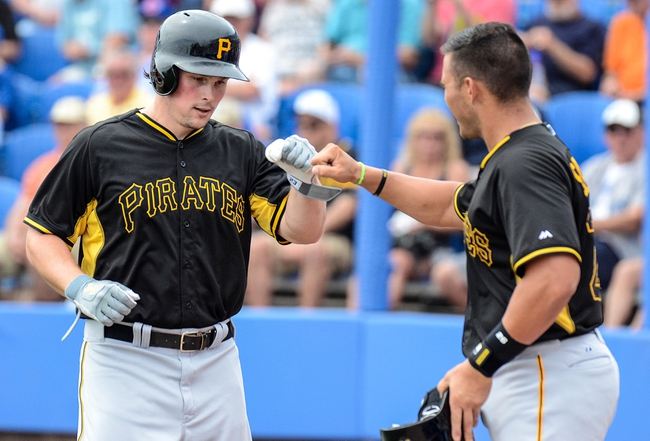Mar 5, 2014; Dunedin, FL, USA; Pittsburg Pirates outfielder Travis Synder (23) celebrates his home run with third basemen Brent Morel (79) during the spring training exhibition game against the Toronto Blue Jays  at Florida Auto Exchange Park. Mandatory Credit: Jonathan Dyer-USA TODAY Sports