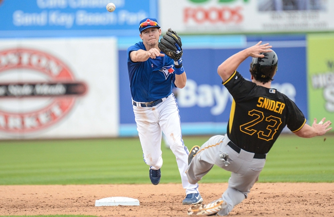 Mar 5, 2014; Dunedin, FL, USA; Toronto Blue Jays infielder Chris Getz (39) prepares to turn a double play as Pittsburg Pirates outfielder Travis Synder (23) slides into second at Florida Auto Exchange Park. Mandatory Credit: Jonathan Dyer-USA TODAY Sports