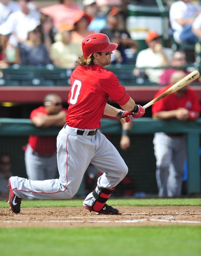March 5, 2014; Scottsdale, AZ, USA; Los Angeles Angels outfielder Colin Cowgill (0) hits a double in the second inning against the San Francisco Giants  at Scottsdale Stadium. Mandatory Credit: Gary A. Vasquez-USA TODAY Sports