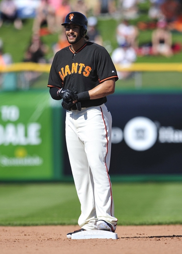 March 5, 2014; Scottsdale, AZ, USA; San Francisco Giants left fielder Michael Morse (38) reacts after hitting an RBI double in the fifth inning against the Los Angeles Angels at Scottsdale Stadium. Mandatory Credit: Gary A. Vasquez-USA TODAY Sports