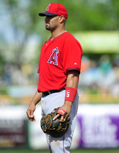 March 5, 2014; Scottsdale, AZ, USA; Los Angeles Angels first baseman Albert Pujols (5) against the San Francisco Giants  at Scottsdale Stadium. Mandatory Credit: Gary A. Vasquez-USA TODAY Sports