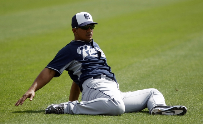 Mar 5, 2014; Phoenix, AZ, USA; San Diego Padres shortstop Alberto Gonzalez (3) stretches before a game against the Chicago White Sox at Camelback Ranch. Mandatory Credit: Rick Scuteri-USA TODAY Sports