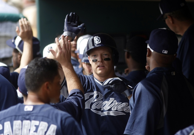 Mar 5, 2014; Phoenix, AZ, USA; San Diego Padres catcher Nick Hundley (4) celebrates with teammates after hitting a three run home run during the first inning against the Chicago White Sox at Camelback Ranch. Mandatory Credit: Rick Scuteri-USA TODAY Sports