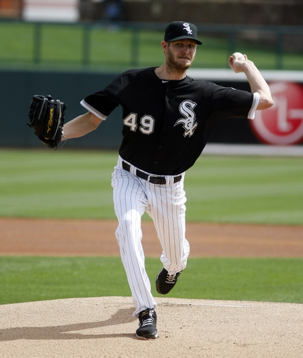 Mar 5, 2014; Phoenix, AZ, USA; Chicago White Sox starting pitcher Chris Sale (49) throws during the first inning against the San Diego Padres at Camelback Ranch. Mandatory Credit: Rick Scuteri-USA TODAY Sports
