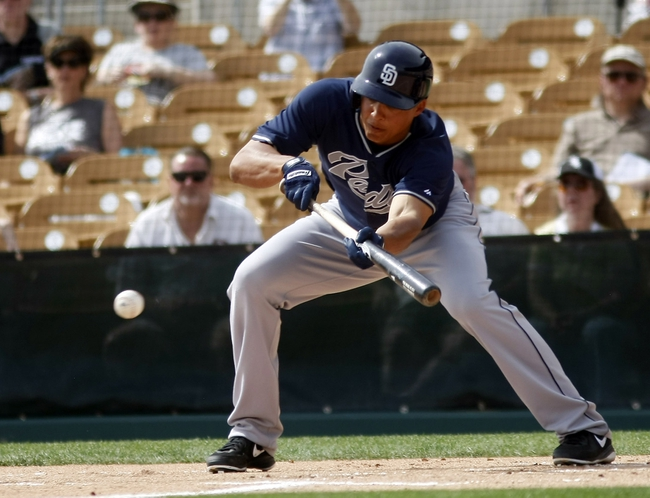 Mar 5, 2014; Phoenix, AZ, USA; San Diego Padres center fielder Will Venable (25) bunts during the first inning against the Chicago White Sox at Camelback Ranch. Mandatory Credit: Rick Scuteri-USA TODAY Sports