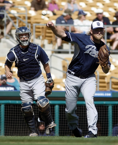 Mar 5, 2014; Phoenix, AZ, USA; San Diego Padres right fielder Rymer Liriano (64) makes the throw to first base for the out against the Chicago White Sox during the third inning at Camelback Ranch. Mandatory Credit: Rick Scuteri-USA TODAY Sports
