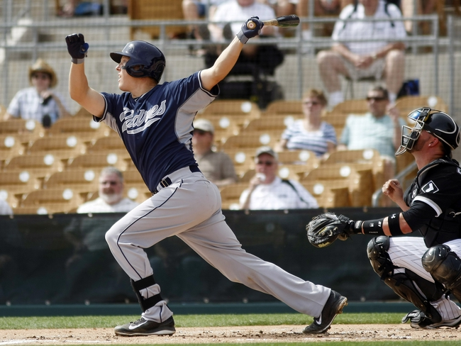 Mar 5, 2014; Phoenix, AZ, USA; San Diego Padres catcher Nick Hundley (4) hits a three run home run during the first inning against the Chicago White Sox at Camelback Ranch. Mandatory Credit: Rick Scuteri-USA TODAY Sports