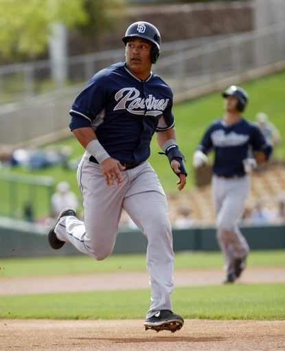 Mar 5, 2014; Phoenix, AZ, USA; San Diego Padres shortstop Everth Cabrera (2) runs to third base on a fly ball during the first inning against the Chicago White Sox at Camelback Ranch. Mandatory Credit: Rick Scuteri-USA TODAY Sports
